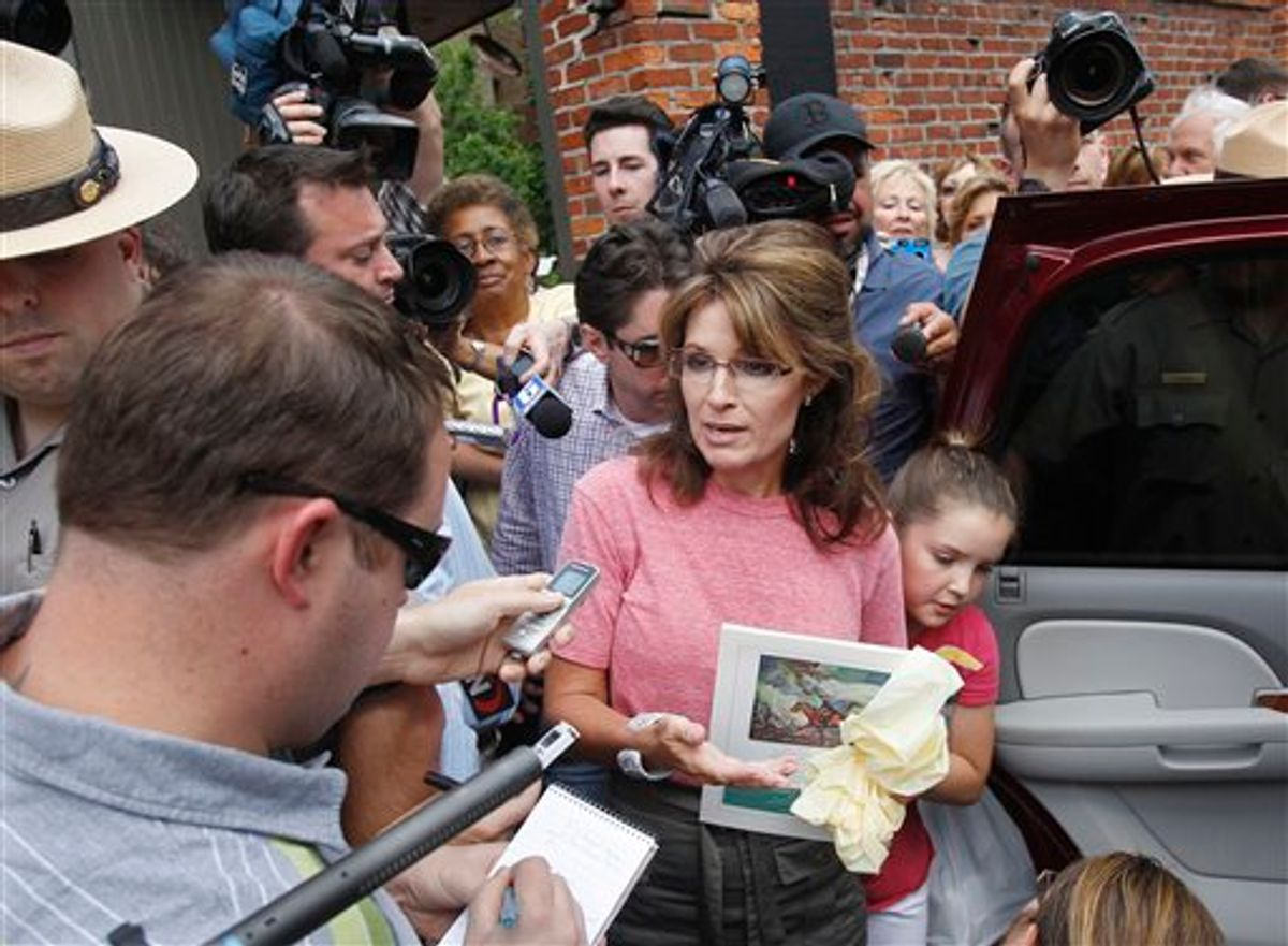 Former Alaska Gov. Sarah Palin, accompanied by her youngest daughter Piper, right, speaks briefly with the media as she tours Boston's North End neighborhood, Thursday,  June 2, 2011. (AP Photo/Steven Senne) (AP)