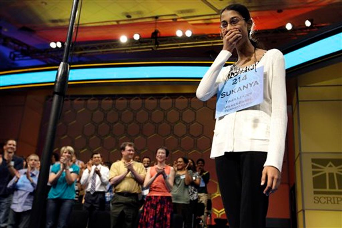 Sukanya Roy, 14, of South Abington Township, Pa., reacts after winning the National Spelling Bee, in Oxon Hill, Md. on Thursday, June 2, 2011. She won by spelling the word cymotrichous, which means wavy hair. (AP Photo/Jacquelyn Martin) (AP)