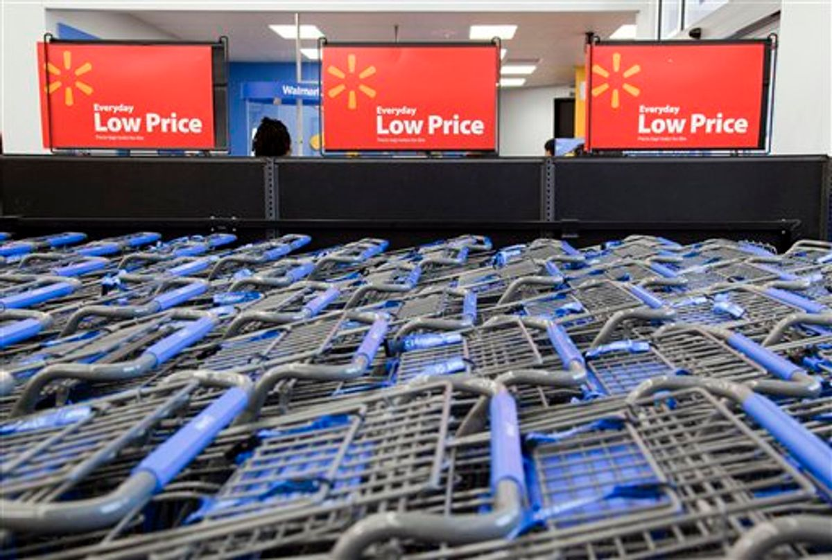 FILE - In this file photo take Dec. 15, 2010, shopping carts are shown inside a Wal-Mart store in Alexandria, Va. As Wal-Mart Stores Inc., the world's largest retailer, restores thousands of products it slashed in an overzealous bid to clean up its stores, it's going back to its roots like catering to enthusiasts of hunting and fishing, while experimenting in new areas. (AP Photo)  (AP)