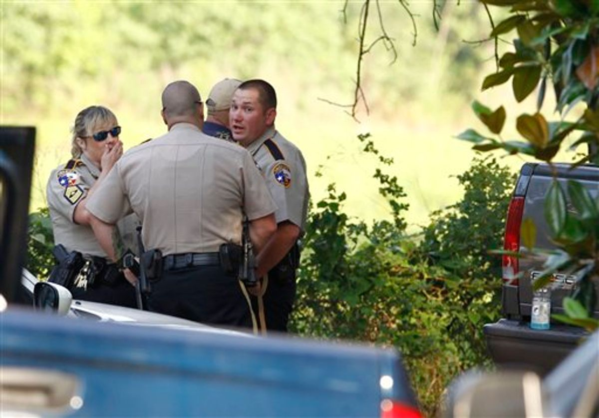 Law enforcement officials are on the scene of a home in Hardin, Texas Tuesday, June 7, 2011, after receiving an anonymous tip that multiple dismembered bodies were buried there. A sheriff's spokesman said officials were seeking a search warrant for the property. (AP Photo/Houston Chronicle, Nick de la Torre) (AP)