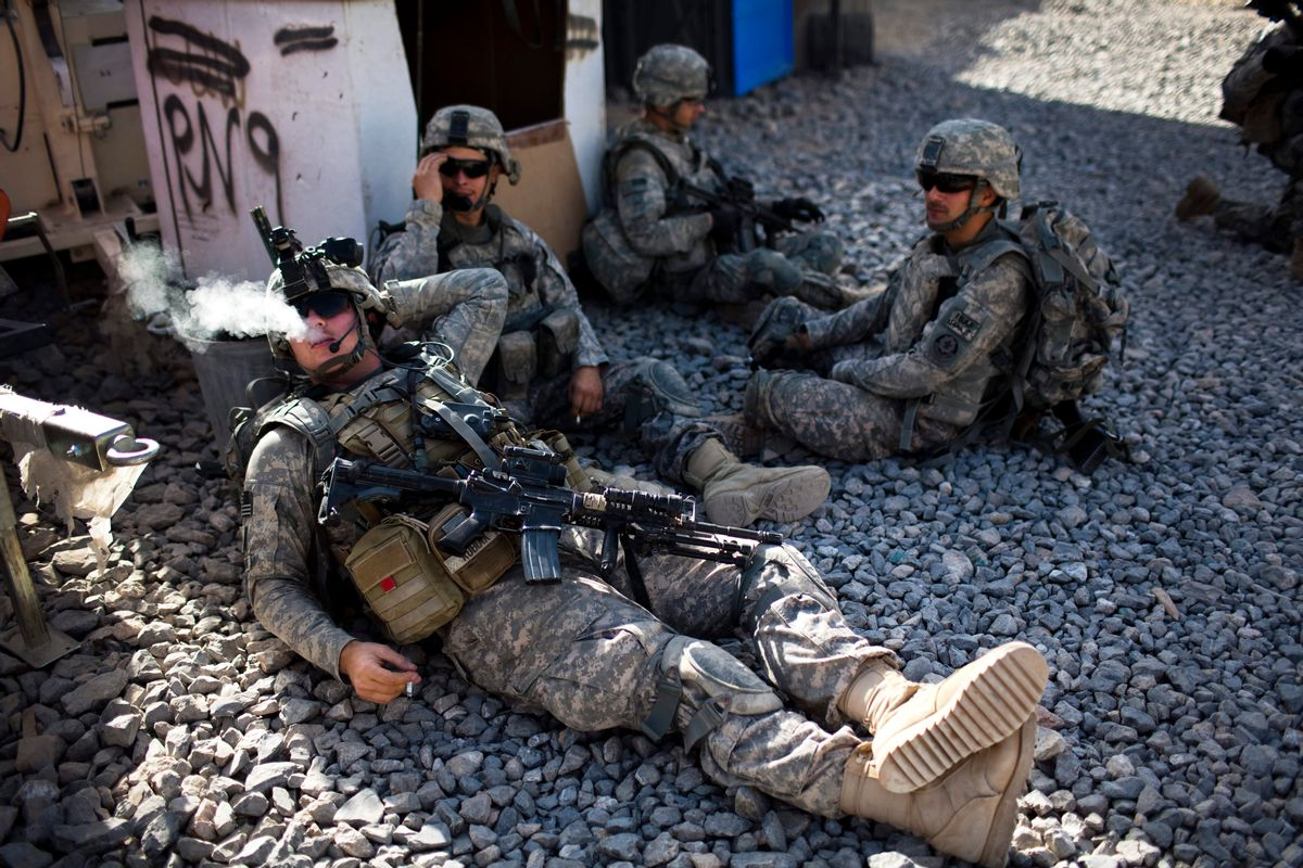 Unidentified US soldiers from L Troop, 4/2SCR, rest, before a foot patrol in Kandahar City, Afghanistan, Friday, Oct. 22, 2010. (AP Photo/Rodrigo Abd) (Associated Press)