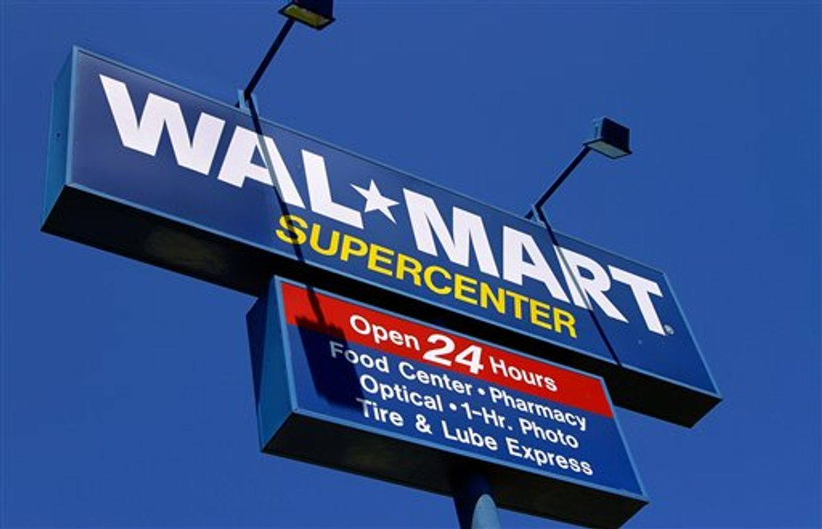 The WalMart Supercenter signage is seen in Springfield, Ill., Monday, May 16, 2011. Wal-Mart Stores Inc. is reporting Tuesday, May 17, a 3 percent increase in first-quarter net income, beating Wall Street expectations because of robust international business and cost controls.  (AP Photo/Seth Perlman)  (AP)