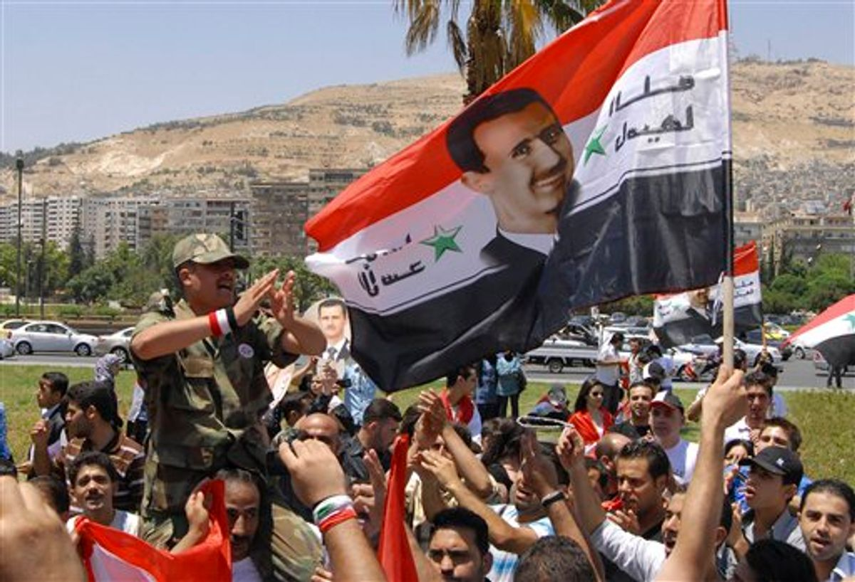 """Pro-Syrian regime protesters, shout pro-Syria's President Bashar Assad slogans after he delivered a speech, in Damascus, Syria, Monday, June 20, 2011. Syria's embattled president says """"saboteurs"""" are trying to exploit legitimate demands for reform in the country. President Bashar Assad's speech Monday was only his third public address since the country's uprising began in March. What is happening today has nothing to do with reform, it has to do with vandalism,"""" Assad told a crowd of supporters at Damascus University. """"There can be no development without stability, and no reform through vandalism. ... We have to isolate the saboteurs."""" (AP Photo/Muzaffar Salman) (AP)"""
