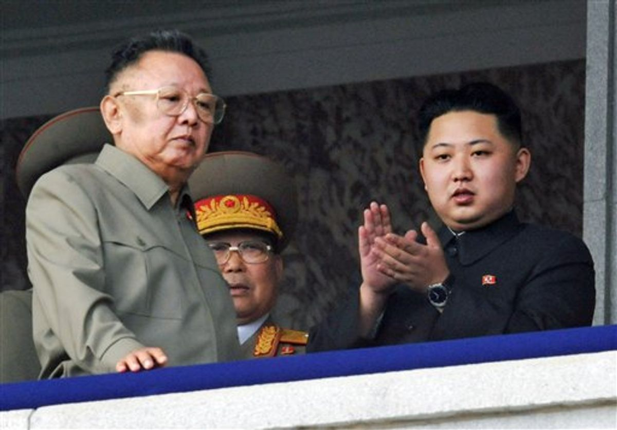 FILE - In this Oct. 10, 2010 file photo Kim Jong Un, right, along with his father and North Korea leader Kim Jong Il, left, attends during a massive military parade marking the 65th anniversary of the ruling Workers' Party in Pyongyang, North Korea.  South Korea's Yonhap News Agency is reporting that the son and heir apparent of North Korean leader Kim Jong Il is visiting China.   The report says Kim Jong Un arrived in the city of Tumen in northeast China on Friday, May 20, 2011. (AP Photo/Kyodo News) JAPAN OUT, MANDATORY CREDIT, NO LICENSING IN CHINA, HONG KONG, JAPAN, SOUTH KOREA AND FRANCE                      (AP)