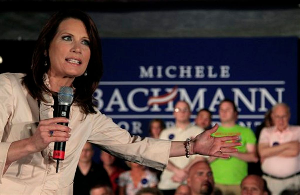 """U.S. Rep. Michele Bachmann, R-Minn., addresses the crowd during a welcome home event in her hometown of Waterloo, Iowa Sunday, June 26, 2011. Republican Rep. Michele Bachmann said Sunday her bid to unseat President Barack Obama shouldn't be viewed as """"anything personal"""" against the Democrat — he's """"just wrong"""" on his policies for America. (AP Photo/Charlie Riedel) (AP)"""