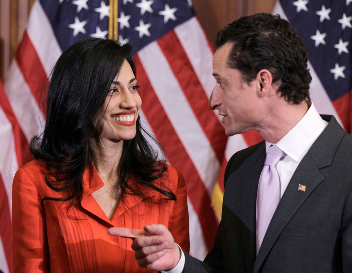Rep. Anthony Weiner, D-N.Y., and his wife, Huma Abedin, an aide to Secretary of State Hillary Rodham Clinton, are pictured after a ceremonial swearing in of the 112th Congress on Capitol Hill in Washington in this photo taken Jan. 5, 2011. (AP Photo/Charles Dharapak) (Charles Dharapak)
