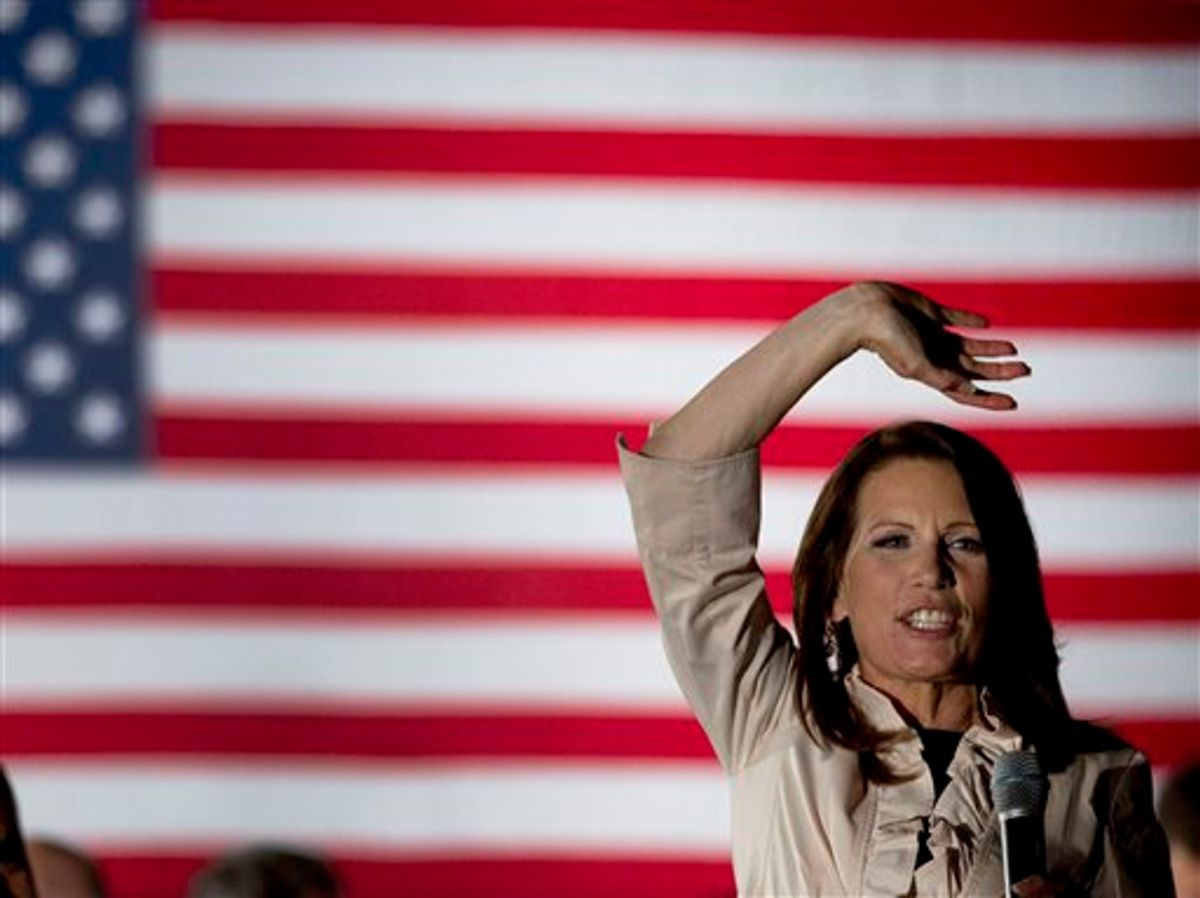 """U.S. Rep. Michele Bachmann, R-Minn., waves to the crowd during a welcome home event in her hometown of Waterloo, Iowa Sunday, June 26, 2011. Bachmann said Sunday her bid to unseat President Barack Obama shouldn't be viewed as """"anything personal"""" against the Democrat. (AP Photo/Charlie Riedel) (AP)"""