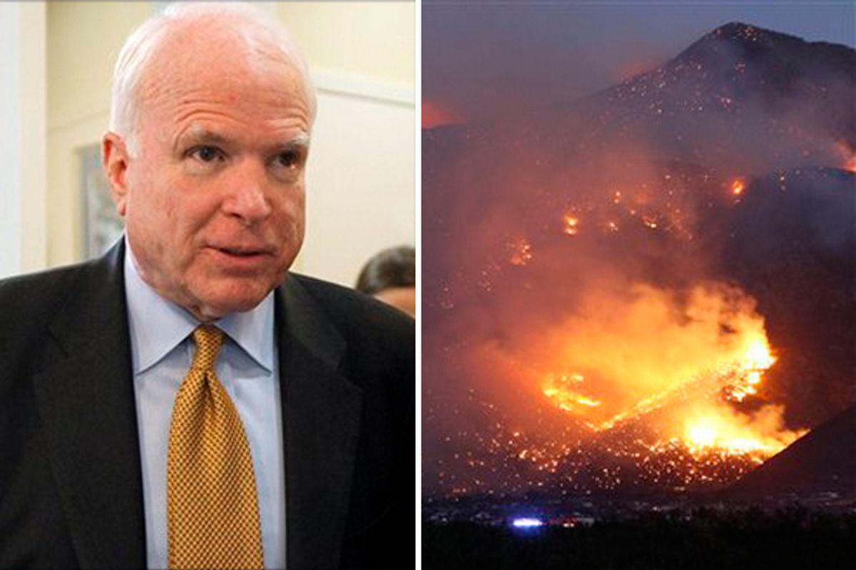 Sen John McCain. Right: The Monument Fire burns a hillside just south of Sierra Vista, Ariz. on Sunday, June 19, 2011.