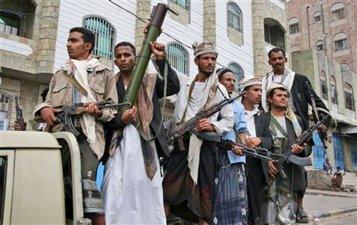 Armed Yemeni tribesmen stand on the back of a vehicle in Taiz, Yemen, Wednesday, June 8, 2011. Hundreds of armed tribesmen have taken control of part of Yemen's second-largest city, Taiz, security officials said Wednesday. The advance on Taiz showed the government's already tenuous control over the country has slipped further since President Ali Abdullah Saleh was wounded in a rocket attack on his compound in the capital Sanaa on Friday and left for medical care in neighboring Saudi Arabia. Saleh left as his country was edging closer to civil war. (AP Photo/Anees Mahyoub) (AP)
