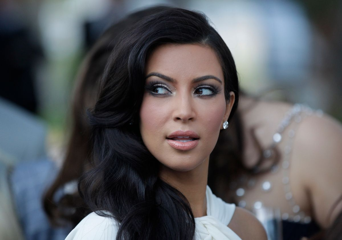 U.S. entertainment icon Kim Kardashian looks on as she addends a charity fashion show in Monaco, Friday, May 27, 2011. The Monaco Formula One Grand Prix will take place here on Sunday, May 29, 2010. (AP Photo/Luca Bruno) (Associated Press)