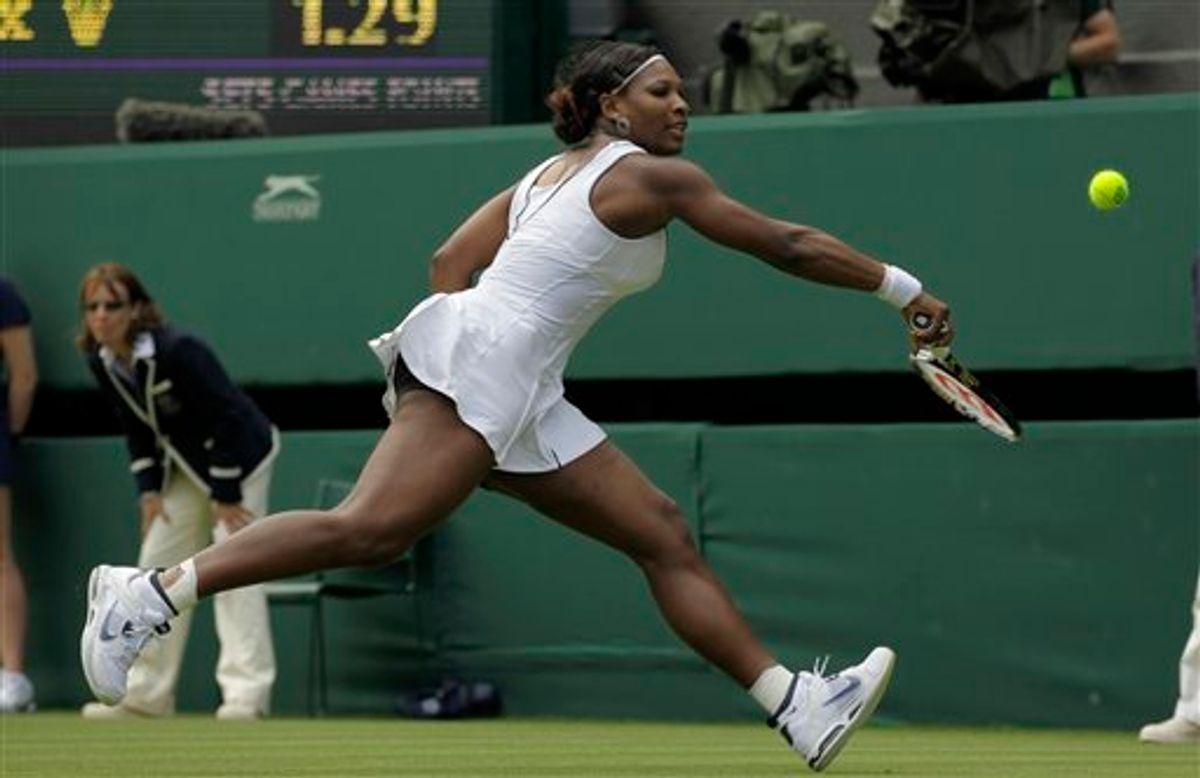Serena Williams of the US returns a shot to France's Aravane Rezai at the All England Lawn Tennis Championships at Wimbledon, Tuesday, June 21, 2011. (AP Photo/Sang Tan) (AP)
