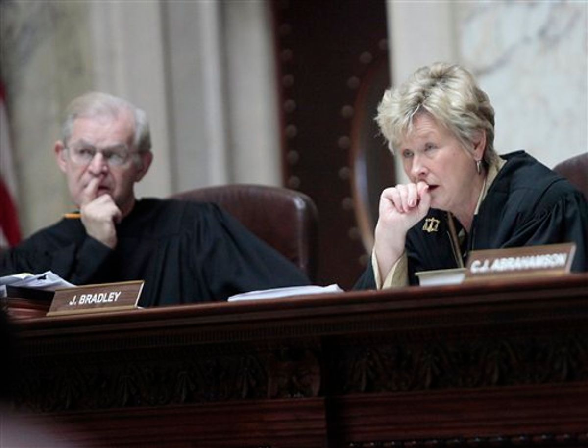 Wisconsin Supreme Court Justices David T. Prosser, Jr. and Ann Walsh Bradley consider oral arguments during a hearing regarding the state's budget bill at the Wisconsin State Capitol, Monday, June 6, 2011. According to a report by Wisconsin Public Radio and the Wisconsin Center for Investigative Journalism, Prosser allegedly grabbed Bradley by the neck with both hands during an argument in Walsh's chambers prior to the court's decision to uphold the bill. (AP Photo/John Hart, Pool) (AP)
