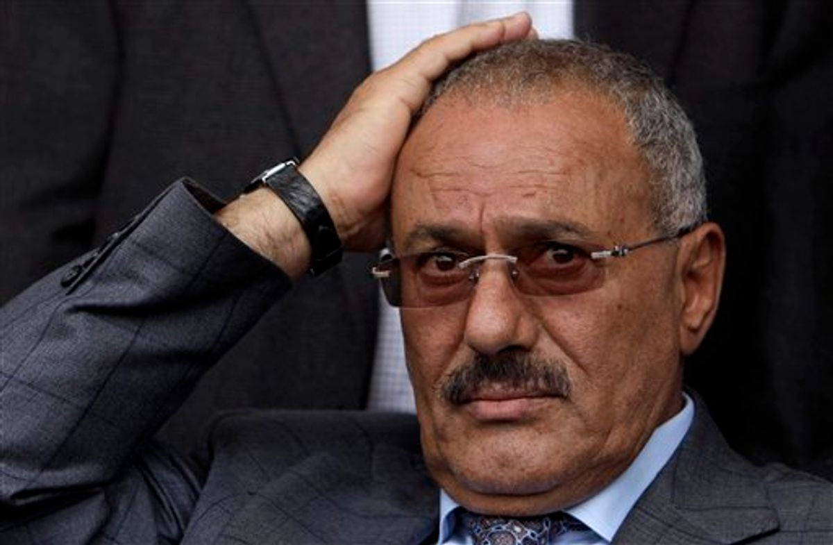 FILE - In this April 8, 2011 file photo, Yemeni President Ali Abdullah Saleh reacts while looking at his supporters, not pictured, during a rally supporting him, in Sanaa,Yemen. A government official says Yemen's president was lightly injured and four top officials wounded when opposition tribesmen struck his palace with rockets, Friday, June 3, 2011. (AP Photo/Muhammed Muheisen, File) (AP)