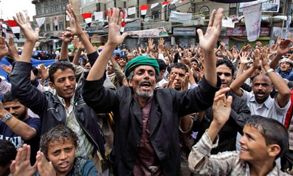 Anti-government protestors, chant slogans during a demonstration demanding the resignation of Yemeni President Ali Abdullah Saleh, in Sanaa, Yemen, Sunday, June 12, 2011. (AP Photo/Hani Mohammed) (AP)