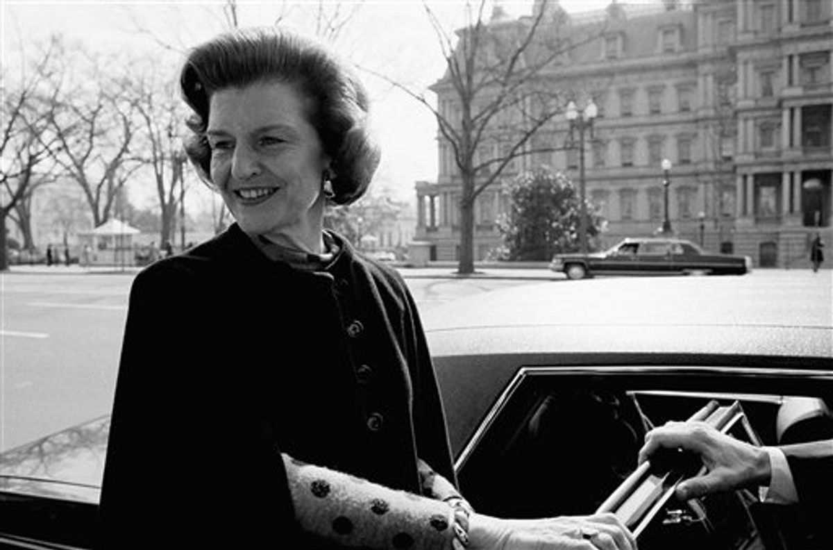FILE - In this Thursday, Feb. 21, 1975 file picture, first lady Betty Ford prepares to enter an automobile in Washington after attending a Chamber of Commerce reception. Ford, the former first lady whose triumph over drug and alcohol addiction became a beacon of hope for addicts and the inspiration for her Betty Ford Center, has died, a family friend said Friday, July 8, 2011. She was 93. (AP Photo/Chick Harrity) (AP)