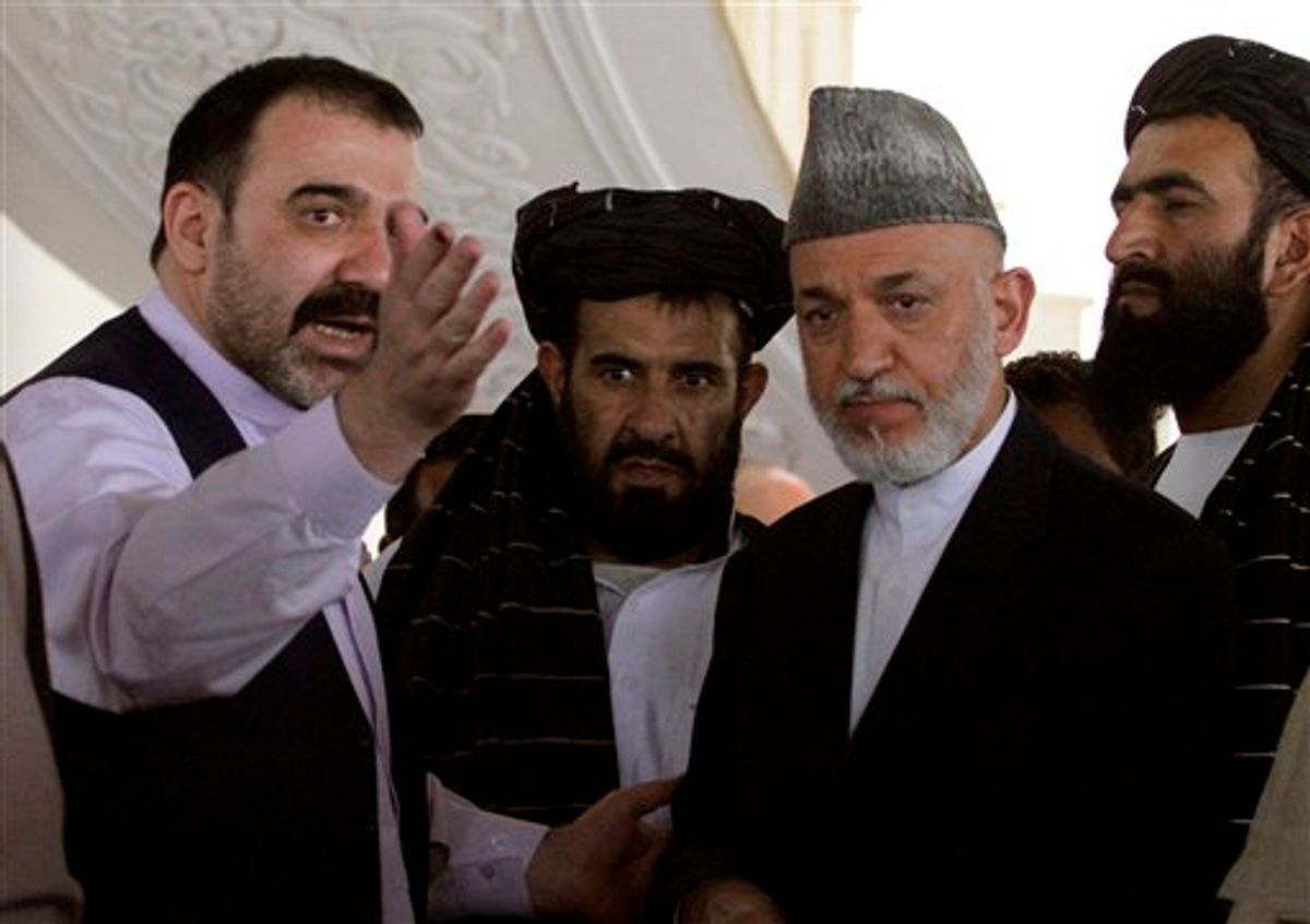 FILE  - In this Saturday, Oct. 9, 2010 file photo Afghan President Hamid Karzai, second from right, is met by his half brother Ahmad Wali Karzai, left, in Argandab district of Kandahar province, south of Kabul, Afghanistan. An Afghan official says Afghan President Hamid Karzai's half brother has been killed in southern Afghanistan. Zalmai Ayubi, the spokesman for Kandahar province, says that Ahmad Wali Karzai was shot dead on Tuesday July 12, 2011. Ahmad Wali Karzai, who was head of the Kandahar provincial council, had become a political liability for the Karzai government _ a symbol of cronyism and a lightning rod for criticism of all that is wrong with the Karzai administration. (AP Photo/Allauddin Khan, file)    (Associated Press)