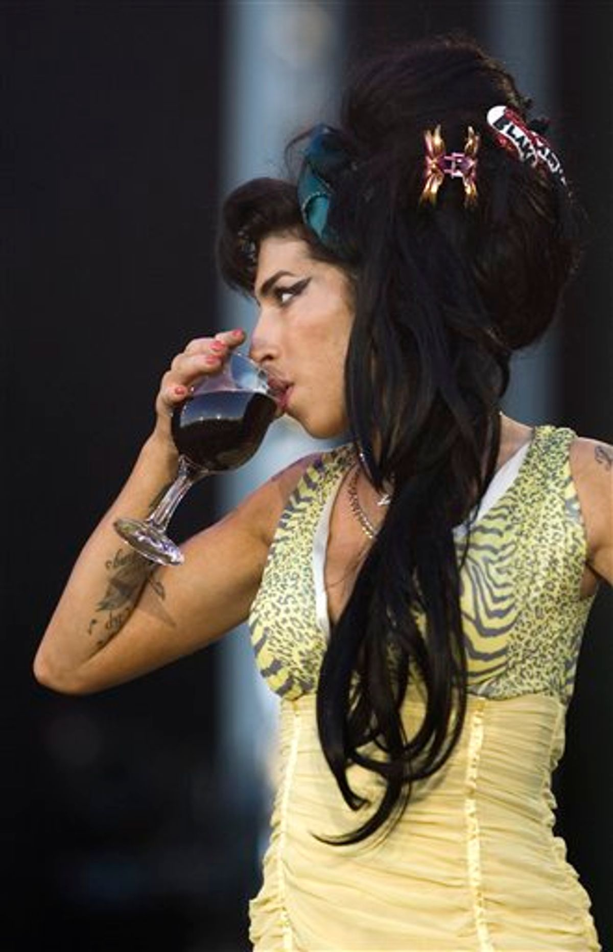 FILE - In this July 4, 2008 file photo, jazz soul singer Amy Winehouse, from England, performs during the Rock in Rio music festival in Arganda del Rey, on the outskirts of Madrid. Amy Winehouse was booed and jeered late Saturday, June 18, 2011 during a concert in Serbia's capital as she stumbled onto the stage, mumbled through her songs and wandered off. (AP Photo/Victor R. Caivano, File) EDITORIAL USE ONLY (AP)