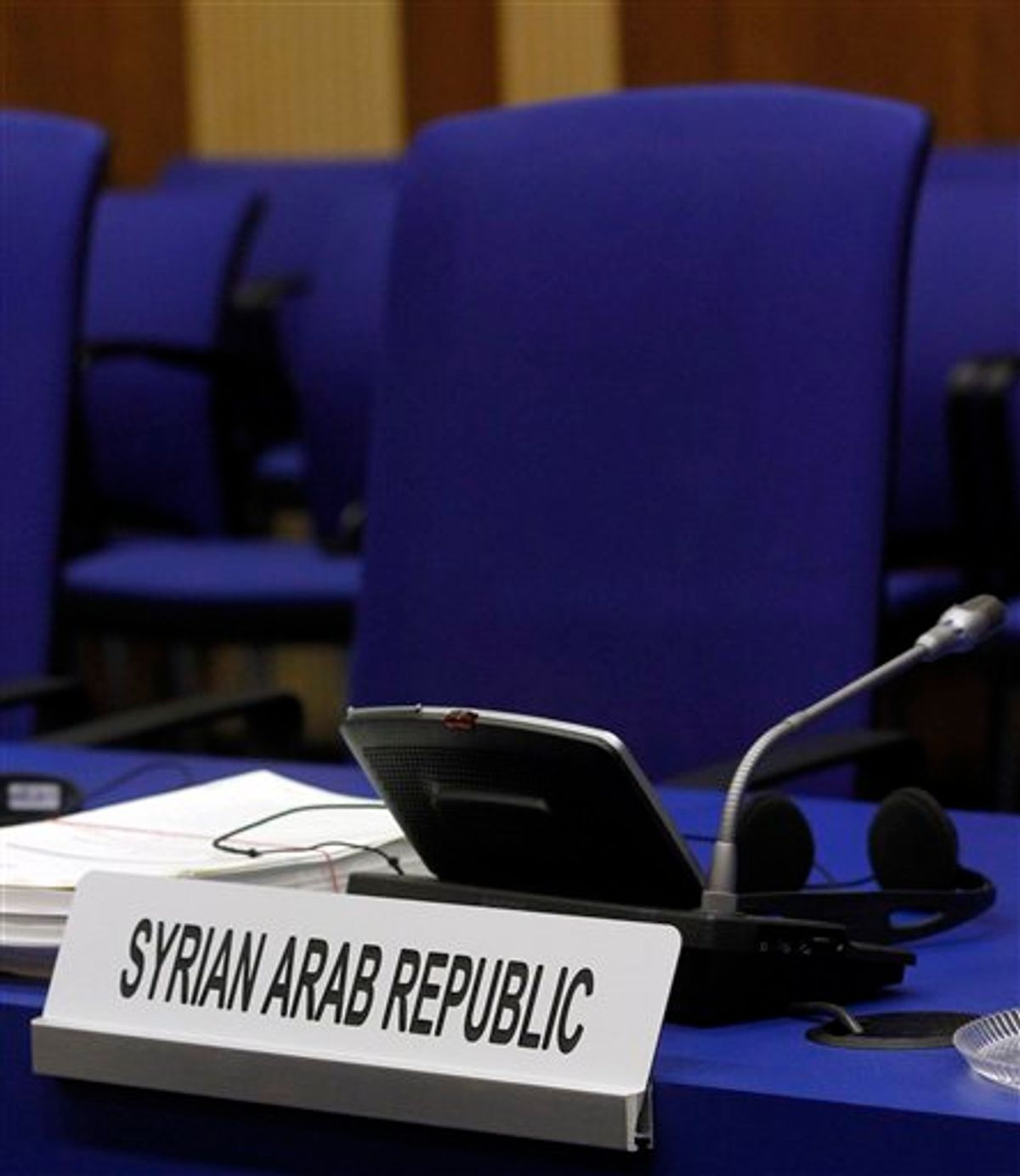 The empty chair of Syria's ambassador to Austria Bassam al-Sabbagh at the start of International Atomic Energy Agency, IAEA's board of governors meeting at the International Center, in Vienna, Austria, on Wednesday, June 8, 2011. (AP Photo/Ronald Zak) (AP)