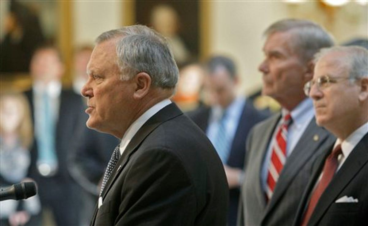 Gov. Nathan Deal  speaks at a  news conference, as former Attorney General Mike Bowers and Dekalb County DA Bob Wilson, right, listen,  on Tuesday, July 5, 2011 in Atlanta.  A probe has found that more than 78 percent of Atlanta schools examined by state investigators engaged in cheating on standardized tests.  Deal said 44 of the 56 schools investigated took part in cheating. Investigators also found that 38 principals were wither responsible for the cheating or were directly involved in it. And they determined that 178 teachers and principals cheated. Of those, 82 confessed to the misconduct.  (AP Photo/Atlanta Journal & Constitution, Bob Andres) (AP)