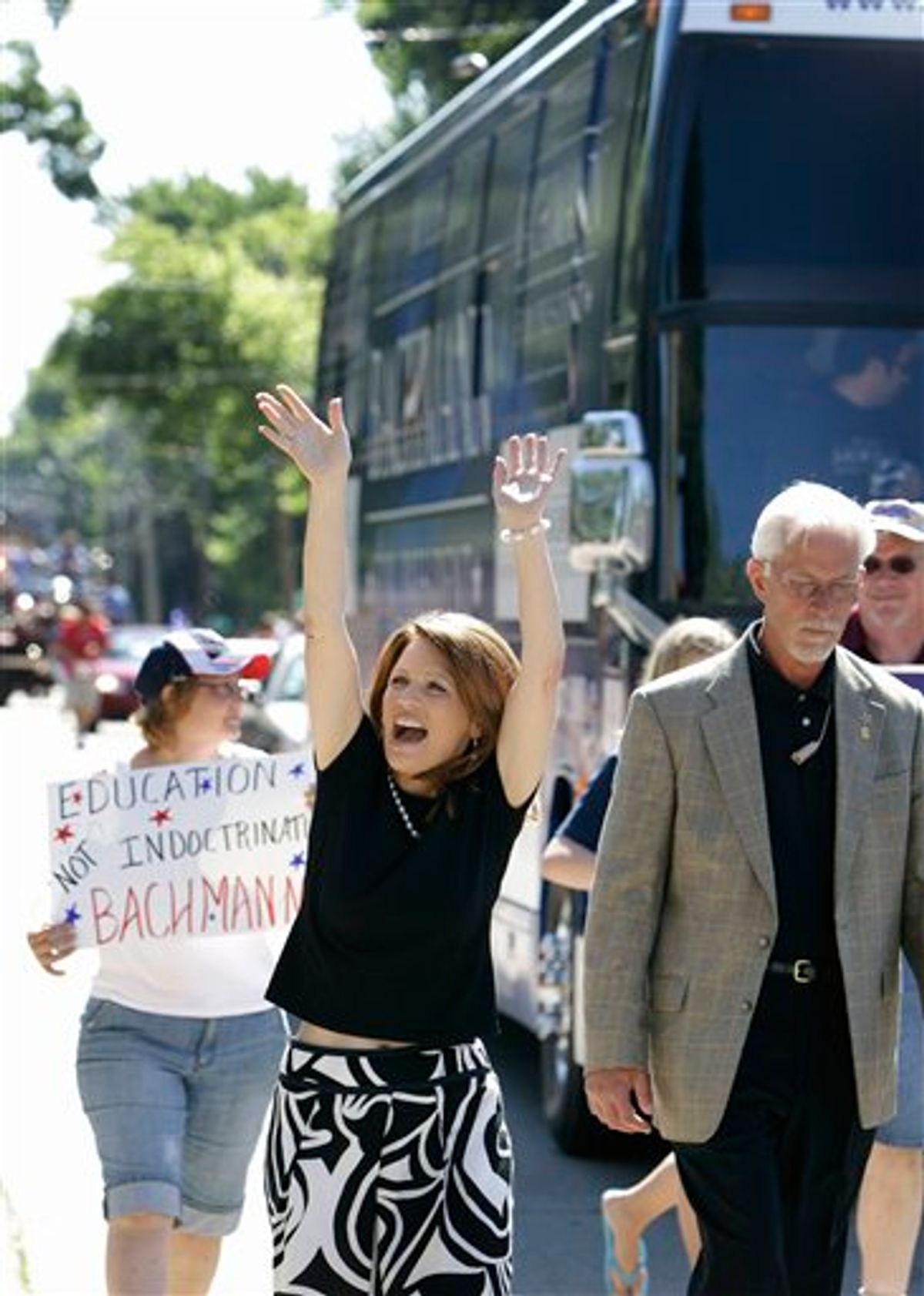Republican presidential candidate, Rep. Michele Bachmann, R-Minn., waves while walking in the Fourth of July parade in Clear Lake, Iowa., Monday, July 4, 2011.  (AP Photo/Charlie Neibergall) (AP)