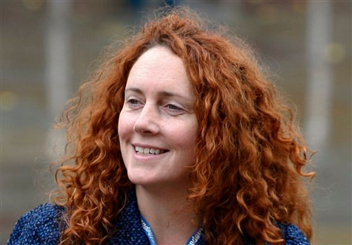 FILE - In this Oct. 6, 2009 file photo, Rebekah Brooks, chief executive of News International, which publishes the News of the World tabloid, arrives at the Conservative Party Conference in Manchester, England. Brooks resigned as Chief executive of News International Friday July 15, 2011 according to News International journalists. (AP Photo/Jon Super, File) (AP)