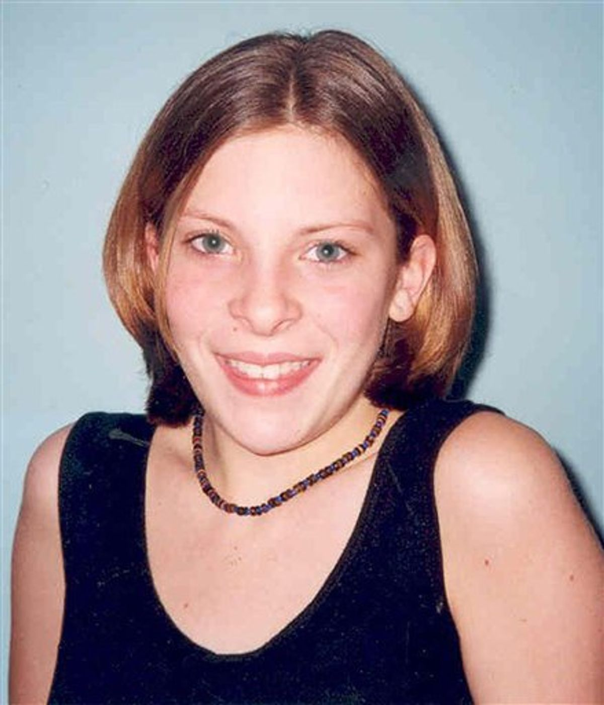 """This is an undated Surrey Police handout photo of Milly Dowler made available Monday July 4, 2011 . Britain 's Prime Minister David Cameron said Tuesday Juily 5, 2011 that he is shocked by allegations that a British tabloid hacked into the cellphone of a murdered schoolgirl  Milly Dowler after she went missing. """"If they are true, this is a truly dreadful act and a truly dreadful situation,"""" Cameron said about the latest hacking allegations against the News of the World. (AP Photo/Surrey Police. Ho) UNITED KINGDOM OUT NO SALES NO ARCHIVE EDITORIAL USE ONLY (AP)"""