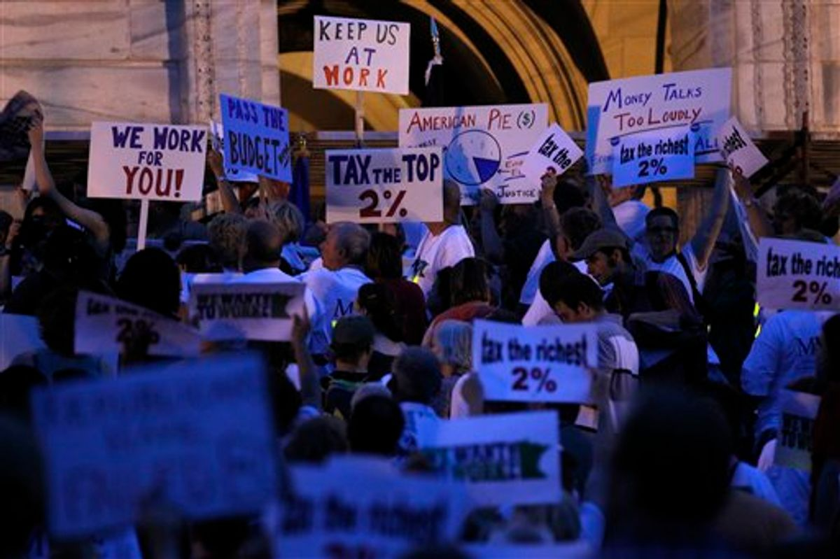 Members of the Minnesota Association of Professional Employees, and the American Federation of State, County and Municipal Employees and their supporters attended a vigil at the State Capitol steps in St. Paul, Minn on Thursday night June 30, 2011. Minnesota stumbled into its second government shutdown in six years on Thursday, with a partisan divide over taxes and spending to close a $5 billion deficit becoming only more bitter as a midnight deadline came and went without agreement. (AP Photo/Carlos Gonzalez - Star Tribune) MANDATORY CREDIT   (AP)