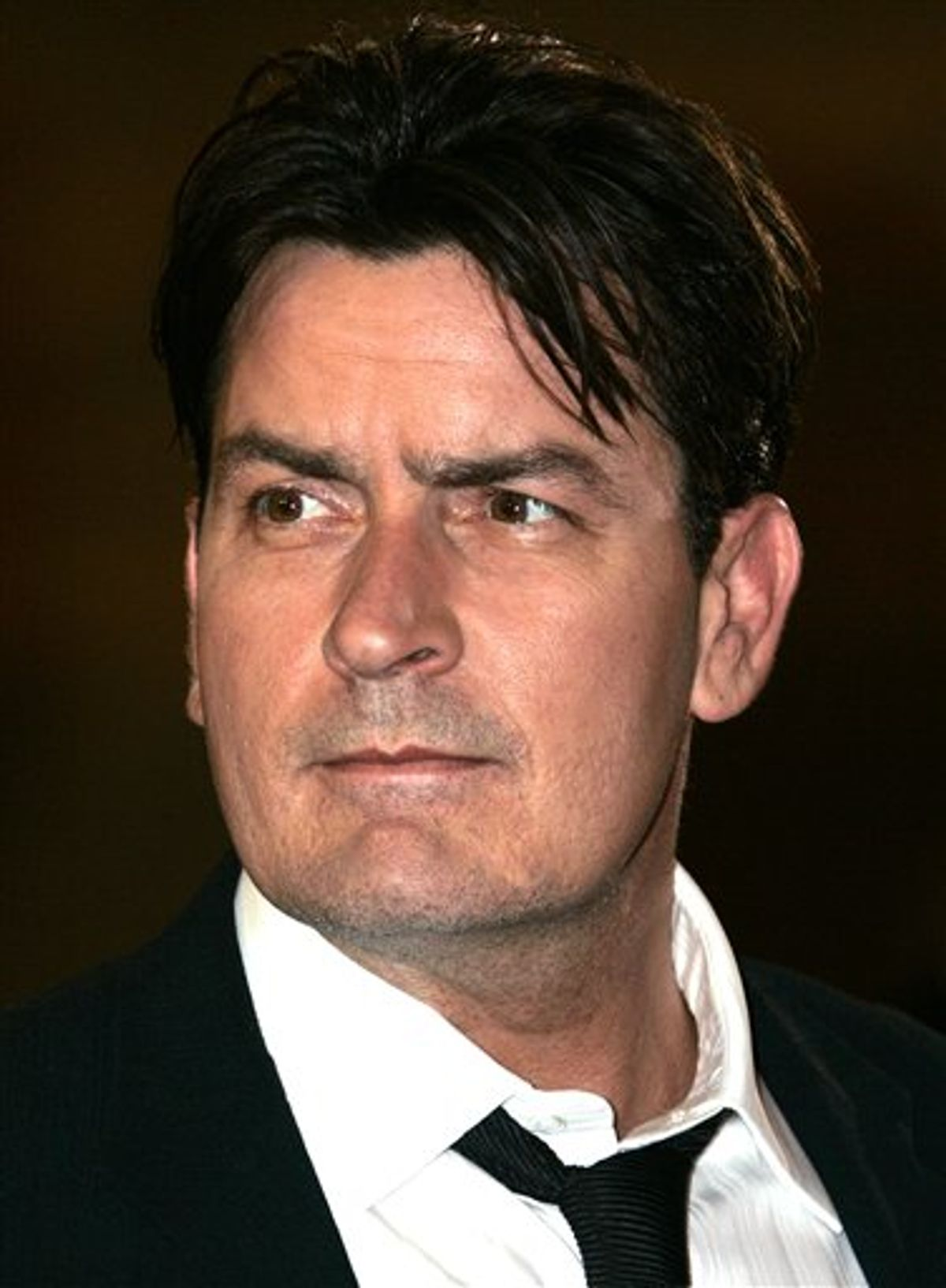 """FILE - This May 21, 2006 file photo shows actor Charlie Sheen as he arrives for the screening of the film """"Platoon,""""at the 59th International Film Festival in Cannes, France. Los Angeles Superior Court Judge Allan Goodman ruled Wednesday, June 15, 2011, that Sheen's $100 million lawsuit over his firing from """"Two and a Half Men"""" should be handled through private arbitration rather than in a public courtroom. (AP Photo/Kirsty Wigglesworth, File) (AP)"""