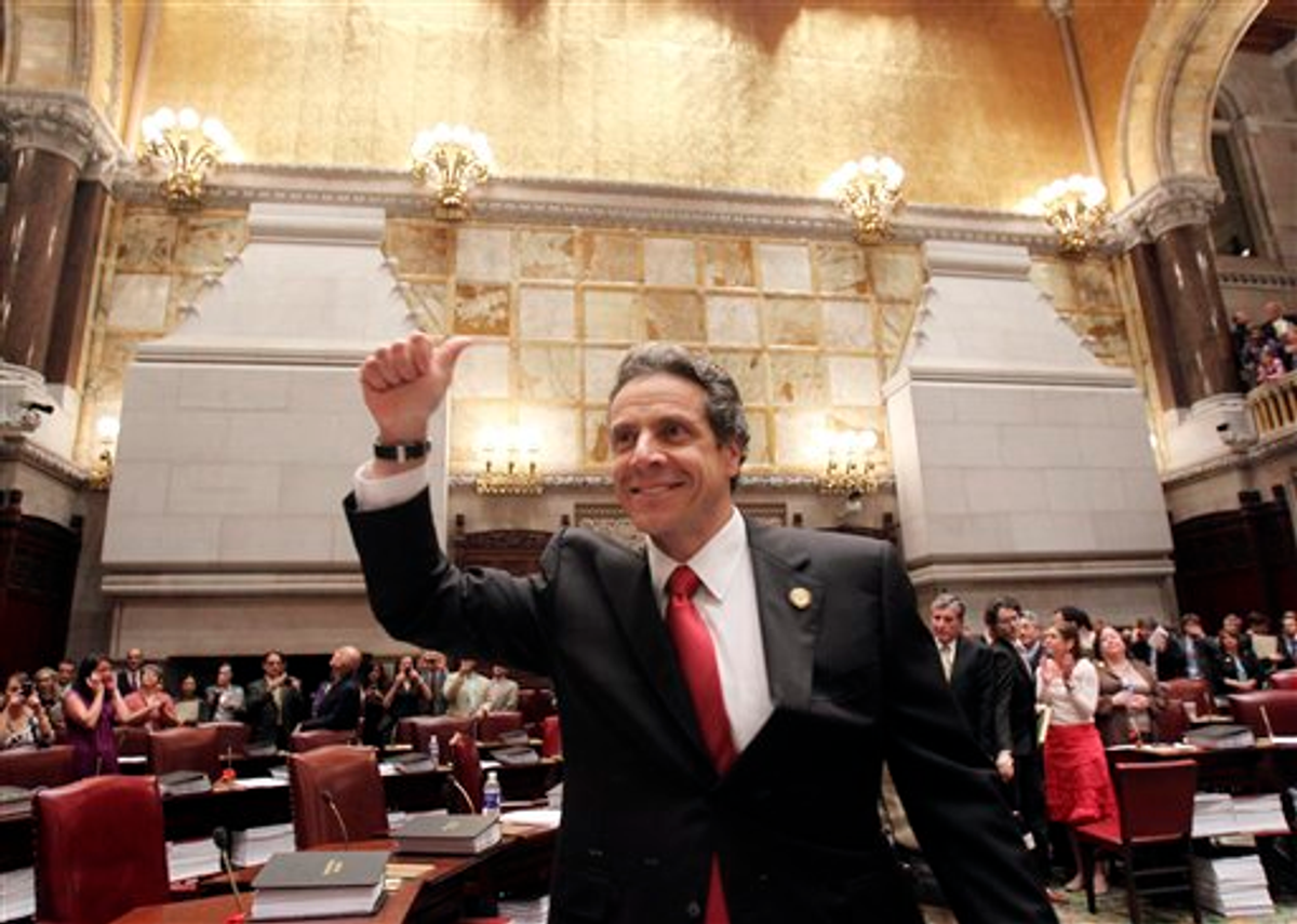 New York Gov. Andrew Cuomo reacts after same-sex marriage is legalized after a vote in the state Senate on June 24.