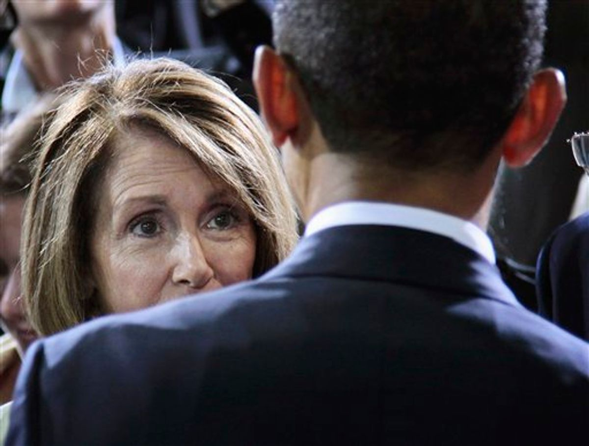 President Barack Obama speaks with House Minority Leader Nancy Pelosi of Calif.,  at the Washington Convention Center in Washington, Friday, July 29, 2011, after delivering remarks on improved Fuel Efficiency Standards for cars and light trucks. (AP Photo/Pablo Martinez Monsivais)   (AP)