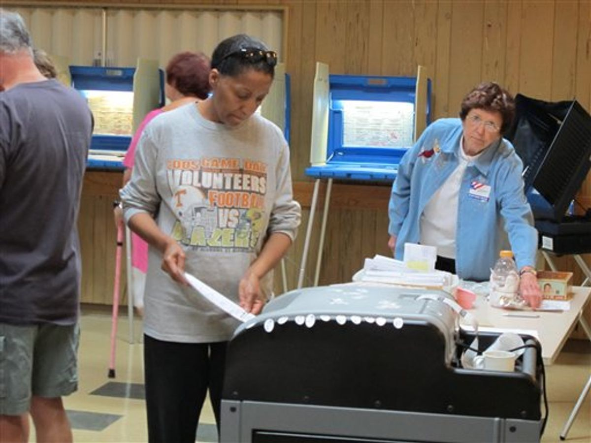 A voter in Glendale, Wis., casts a ballot in a Democratic primary on Thursday, July 12, 2011, as part of recall efforts against Republican state Sen. Alberta Darling. Darling is one of six Republican state senators being targeted for recall for supporting Republican Gov. Scott Walker's budget-repair bill this winter. Three Democratic state senators are also being targeted for recall for fleeing the state to stall action on the bill.  (AP Photo/Dinesh Ramde) (AP)
