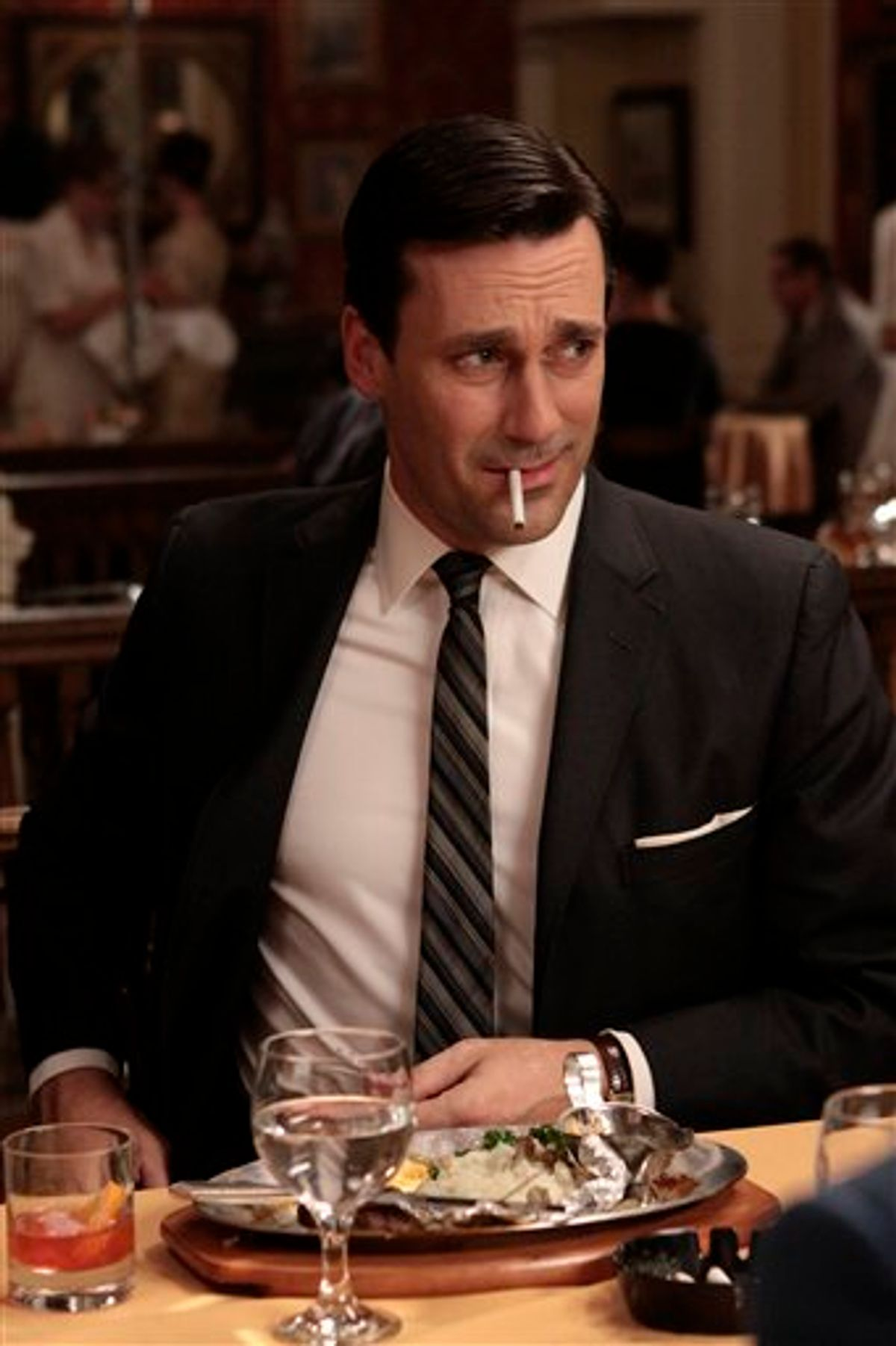 """In this publicity image released by AMC, Jon Hamm portrays Don Draper in the AMC series, """"Mad Men."""" The series was nominated for an Emmy for best drama series, and Jon Hamm was nominated for best actor in a drama series on Thursday, July 14, 2011. The Emmy awards will be presented on Sept. 18. (AP Photo/AMC)     (AP)"""