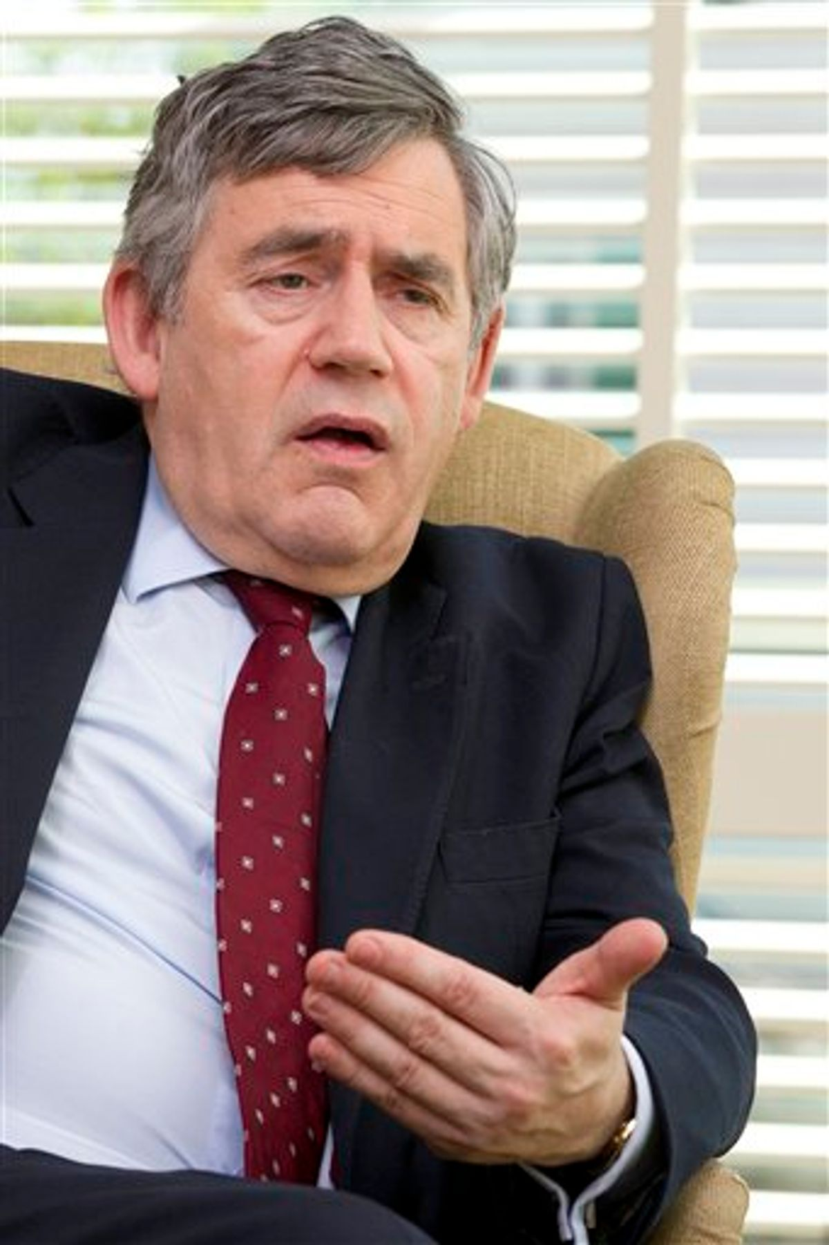 FILE - This is a Tuesday, April 5, 2011 file photo of former British Prime Minister Gordon Brown answers question during an interview with The  Associated Press in  Geneva, Switzerland.   British media say that former Prime Minister Gordon Brown had his personal information targeted by elements of Rupert Murdoch's media empire. (AP Photo/Salvatore Di Nolfi, File) (AP)