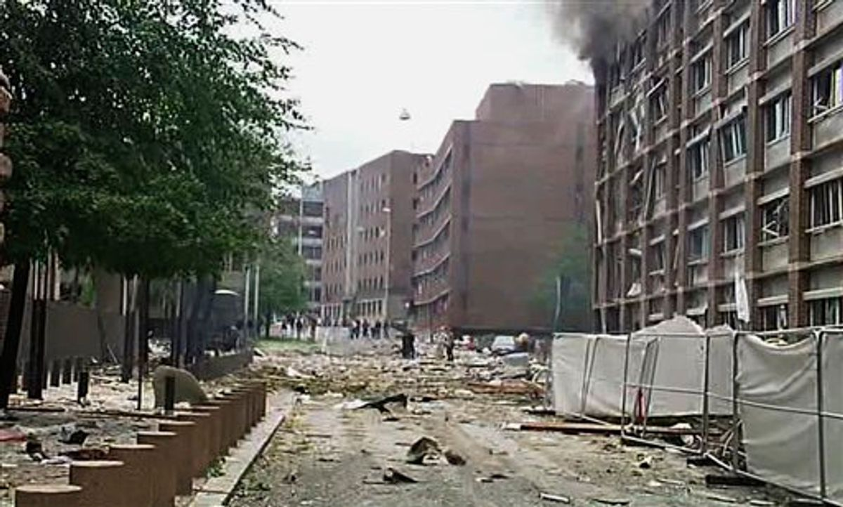 In this video image taken from television, smoke is seen billowing from a damaged building as debris is strewn across the street after an explosion in Oslo, Norway Friday July 22, 2011. A loud explosion shattered windows Friday at the government headquarters in Oslo which includes the prime minister's office, injuring several people. Prime Minister Jens Stoltenberg is safe, government spokeswoman Camilla Ryste told The Associated Press.   (AP Photo/TV2 NORWAY via APTN)   NORWAY OUT (AP)
