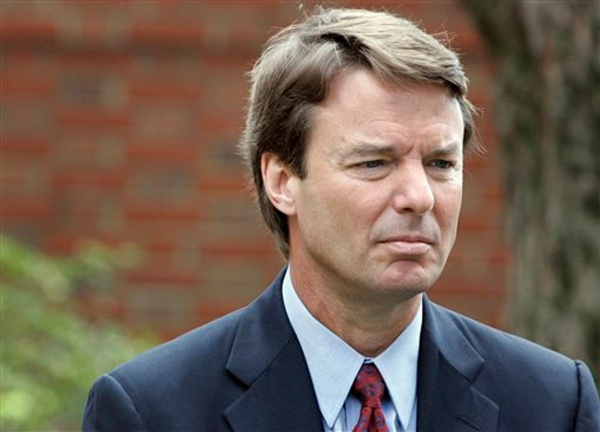 FILE - In this March 22, 2007, file photo Democratic presidential hopeful John Edwards listens to his wife Elizabeth, not shown, talk to media about her recurrence of cancer during a news conference in Chapel Hill, N.C. The legal case against two-time presidential candidate focuses on where to draw the line between the public and private in a politician's life. The central dispute over Edwards' indictment on felony charges is whether money, spent by two supporters to keep his mistress in hiding, were campaign contributions or private gifts from friends. (AP Photo/Gerry Broome, File) (AP)