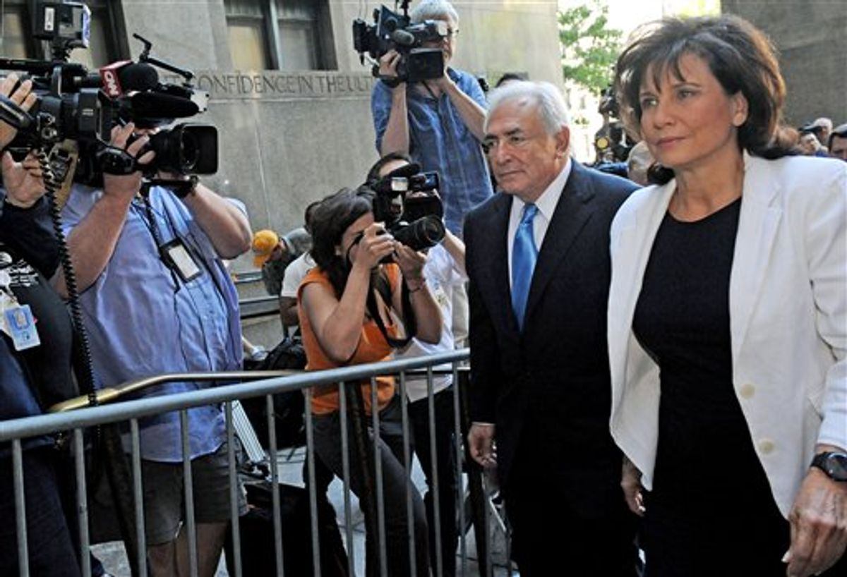 Dominique Strauss- Kahn arrives at Manhattan State Supreme court with his wife Anne Sinclair, Friday, July 1, 2011, in New York. The former International Monetary Fund leader is accused of sexually assaulting a hotel maid at Manhattan's Sofitel hotel.   (AP Photo/Louis Lanzano) (AP)