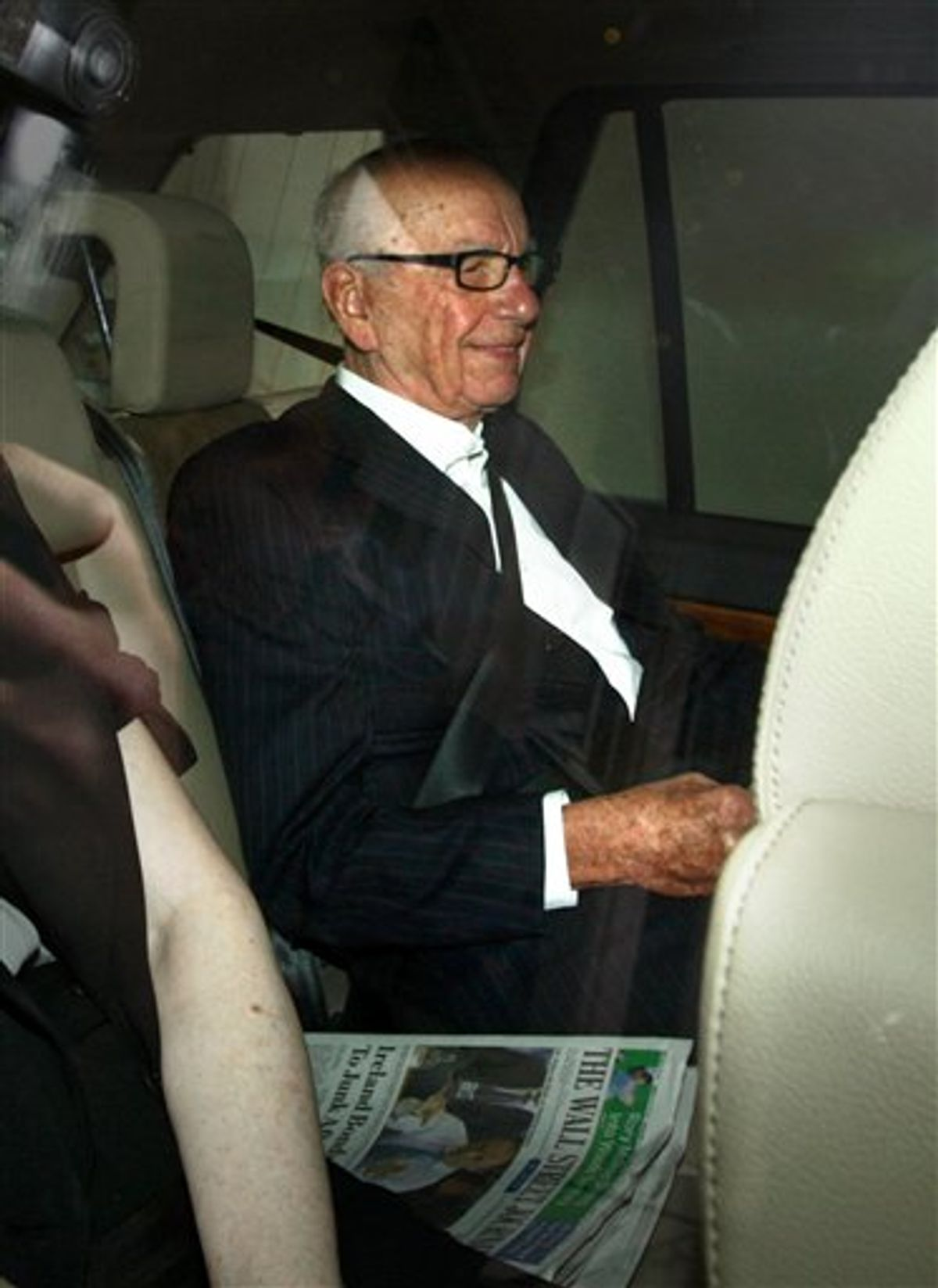 Rupert Murdoch leaves his home in Mayfair, London, as British Prime Minister David Cameron joined demands for the media mogul to drop his BSkyB takeover bid in the wake of the phone-hacking scandal Wednesday July 13, 2011. Britain's House of Commons is poised to demand that Rupert Murdoch give up on his ambition of taking over a lucrative broadcaster while a phone hacking scandal rages around his British newspaper holdings. Cameron has put his party's weight behind an opposition motion up for a vote Wednesday which declares that bidding for full control of British Sky Broadcasting would not be in the national interest. (AP Photo/Steve Parsons)  UNITED KINGDOM OUT NO SALES NO ARCHIVE (AP)