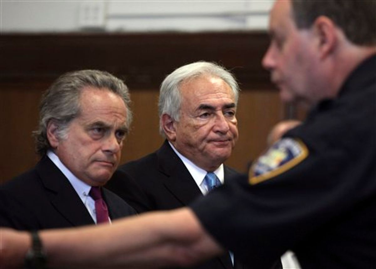 Former International Monetary Fund leader Dominique Strauss-Kahn, center, and his attorney Benjamin Brafman  listen to proceedings in New York state Supreme Court in New York, Friday, July 1, 2011.  A judge has agreed to free former International Monetary Fund leader Strauss-Kahn without bail or home confinement in the sexual assault case against him.  The criminal case against him stands.   (AP Photo/Todd Heisler, Pool) (AP)