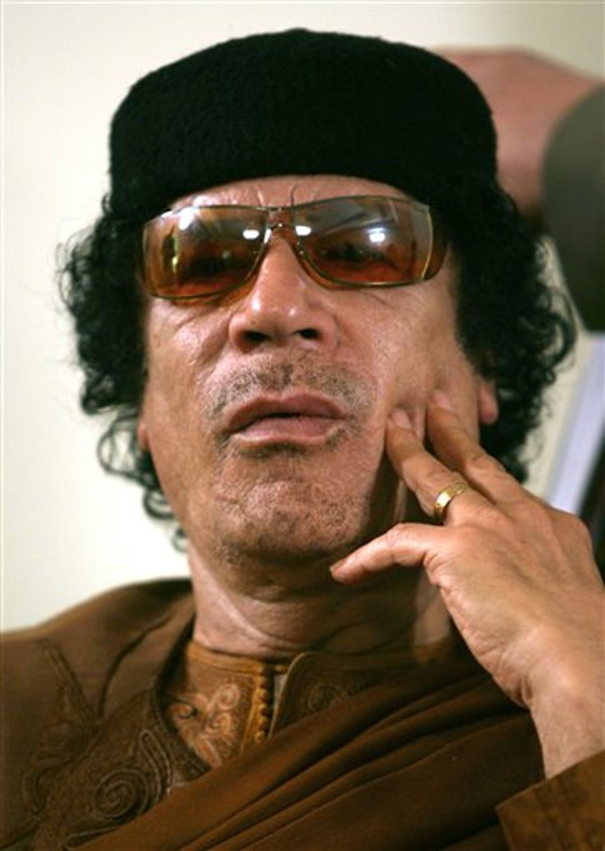 FILE.- This Friday, March 2, 2007 file photo shows Libya's Moammar Gadhafi  in Sabha, Libya Friday, March 2, 2007. The International Criminal Court issued arrest warrants Monday June 27, 2011, for Libyan leader Moammar Gadhafi, his son and his intelligence chief for crimes against humanity in the early days of their struggle to cling to power. (AP Photo/Nasser Nasser, File) (AP)
