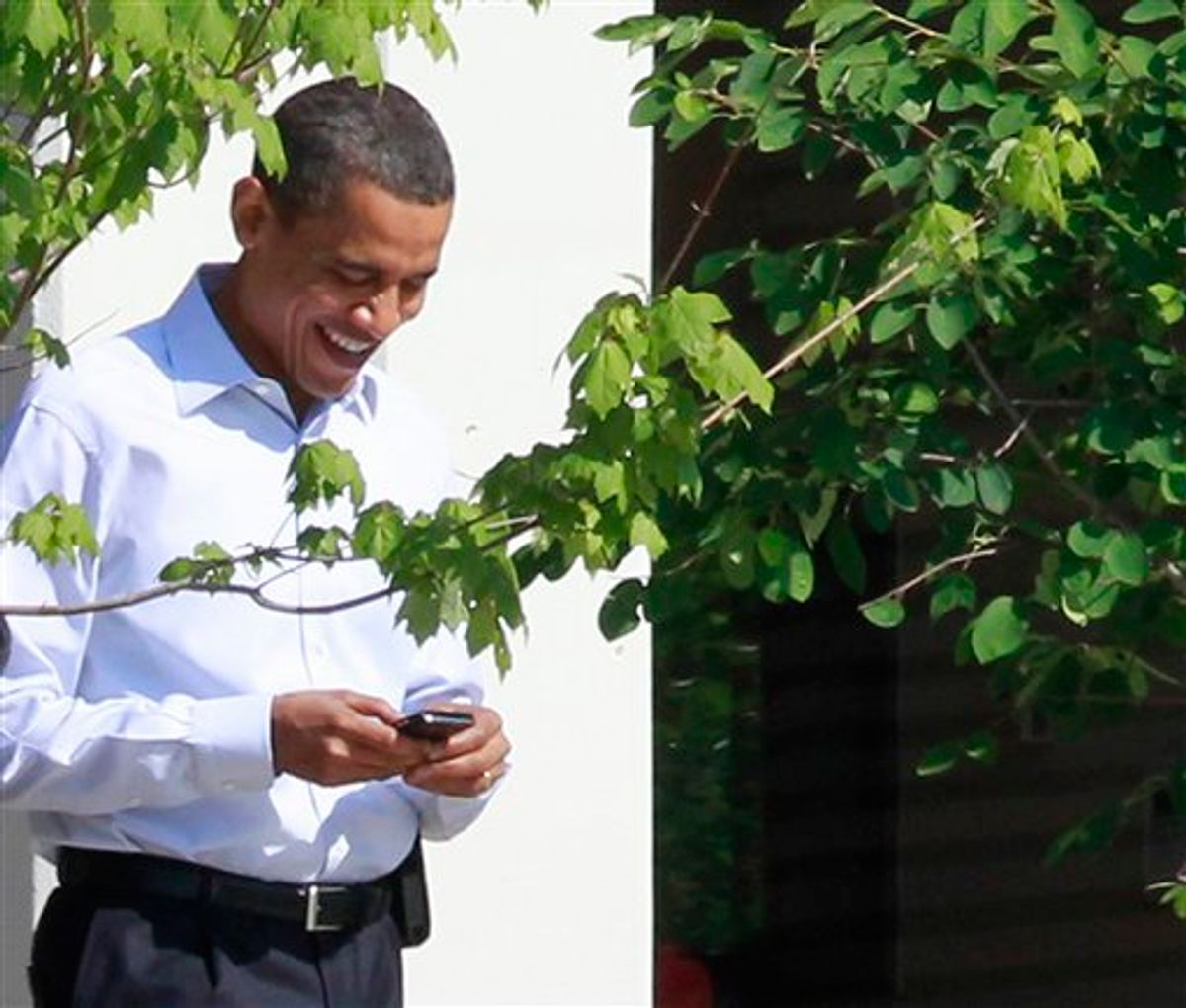"""FILE - In this June 3, 2010 file photo, President Barack Obama uses his BlackBerry e-mail device as he walks at Sidwell Friends school in Bethesda, Md. Call him the Digital Candidate: President Barack Obama has asked supporters to use Facebook to declare """"I'm in"""" for his re-election campaign and has begun using Twitter to communicate with his nearly 9 million followers. If Obama broke new ground using email, text messages and the Web to reach voters in 2008, Obama version 2.0 aims to harness the expansive roles that the Internet and social media are playing now in voters' lives. (AP Photo/Charles Dharapak, File) (AP)"""