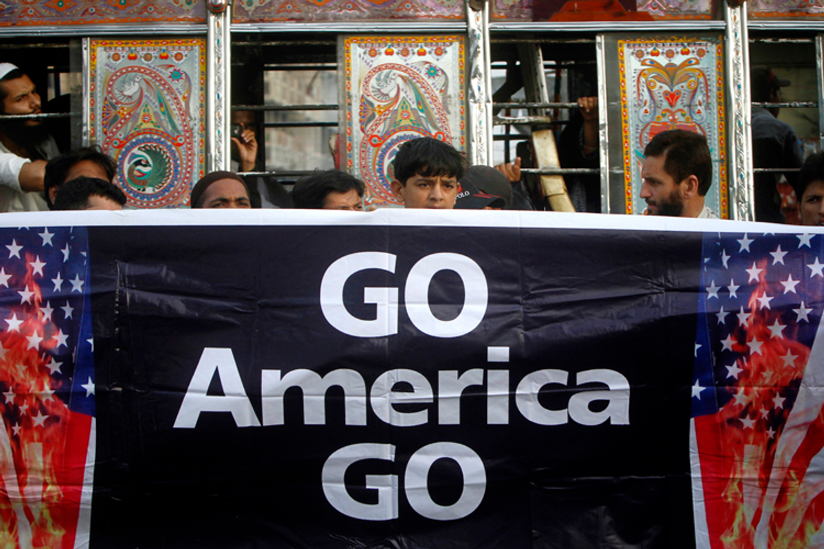 Supporters of Jamaat-e-Islami hold a banner during an anti-American rally through the streets of Karachi May 6, 2011