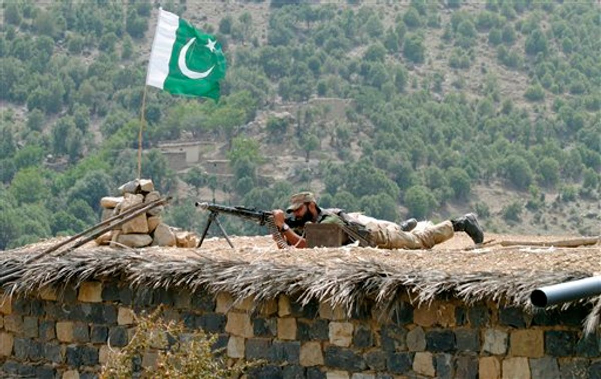 A Pakistani army soldier takes a position during a military operation against militants in Pakistan's Khurram tribal region, Sunday, July 10, 2011.  A military operation in Kurram tribal region has been launched to clear the area of terrorists involved in various terrorist activities, including kidnapping and killing of locals, suicide attacks and blocking the road connecting Lower with upper Kurram, Pakistani army spokesman Maj. Gen. Athar Abbas said. (AP Photo/Mohammad Zubair) (AP)