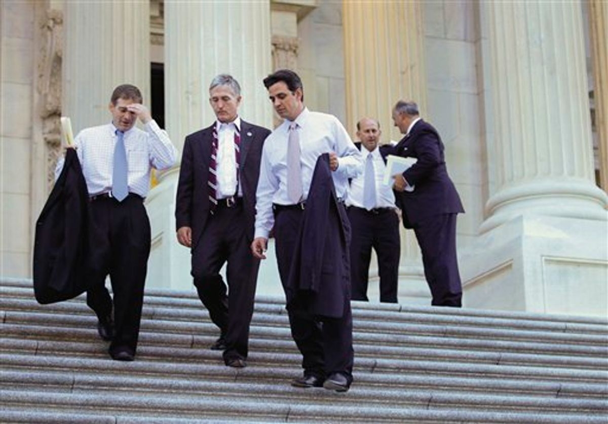 """Rep. Jim Jordan, R-Ohio, the Republican Study Committee chairman, far left, leaves the Capitol with fellow House GOP members after passage of the conservative deficit reduction plan known as """"Cut, Cap and Balance"""" that prevailed 234-190, in Washington, Tuesday, July 19, 2011.  (AP Photo/J. Scott Applewhite) (AP)"""
