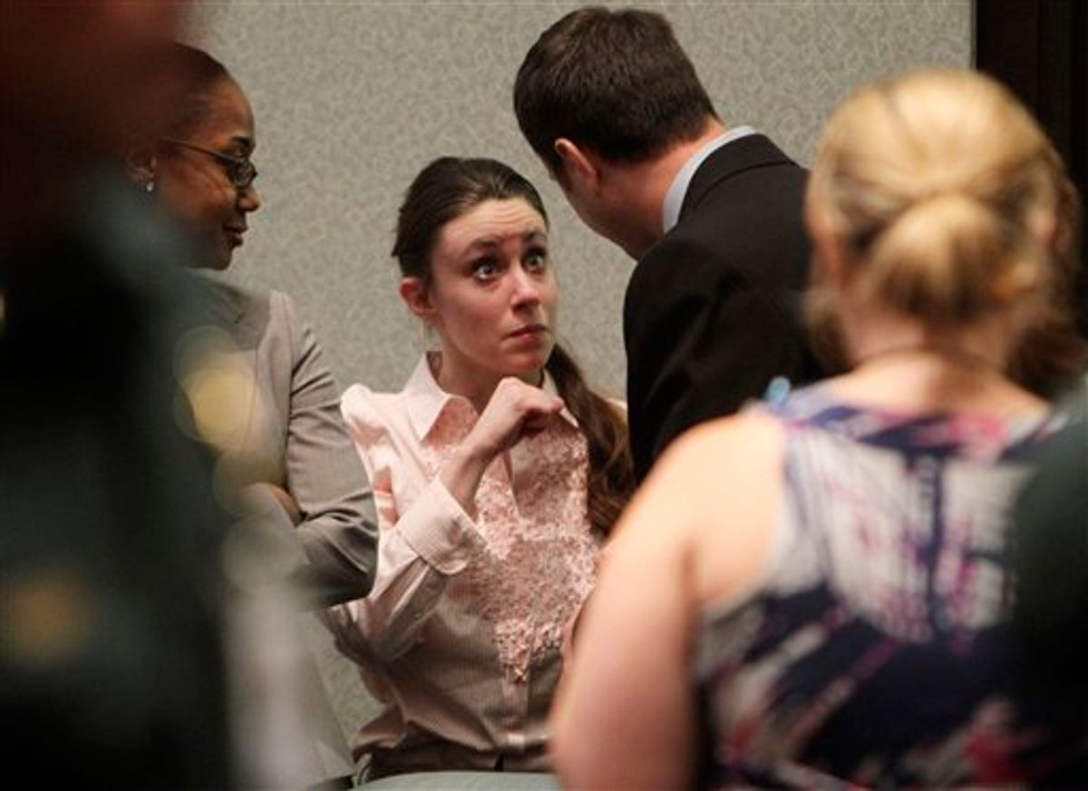 Casey Anthony talks with a supporter in court following the end of her  murder trial where she was acquitted of murder charges in  Orlando, Fla. Tuesday, July 5, 2011. Anthony had been charged with killing her daughter, Caylee.  (AP Photo/Red Huber, Pool) (AP)