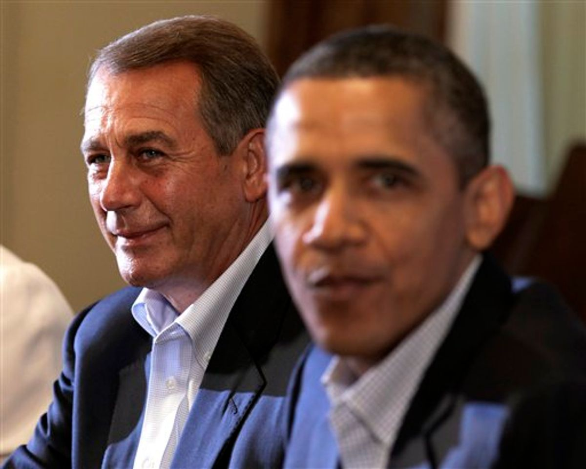House Speaker John Boehner of Ohio, left, and President Barack Obama meet with congressional leaders in the Cabinet Room of the White House,Sunday, July 10, 2011, in Washington, to discuss the debt. (AP Photo/Carolyn Kaster) (AP)