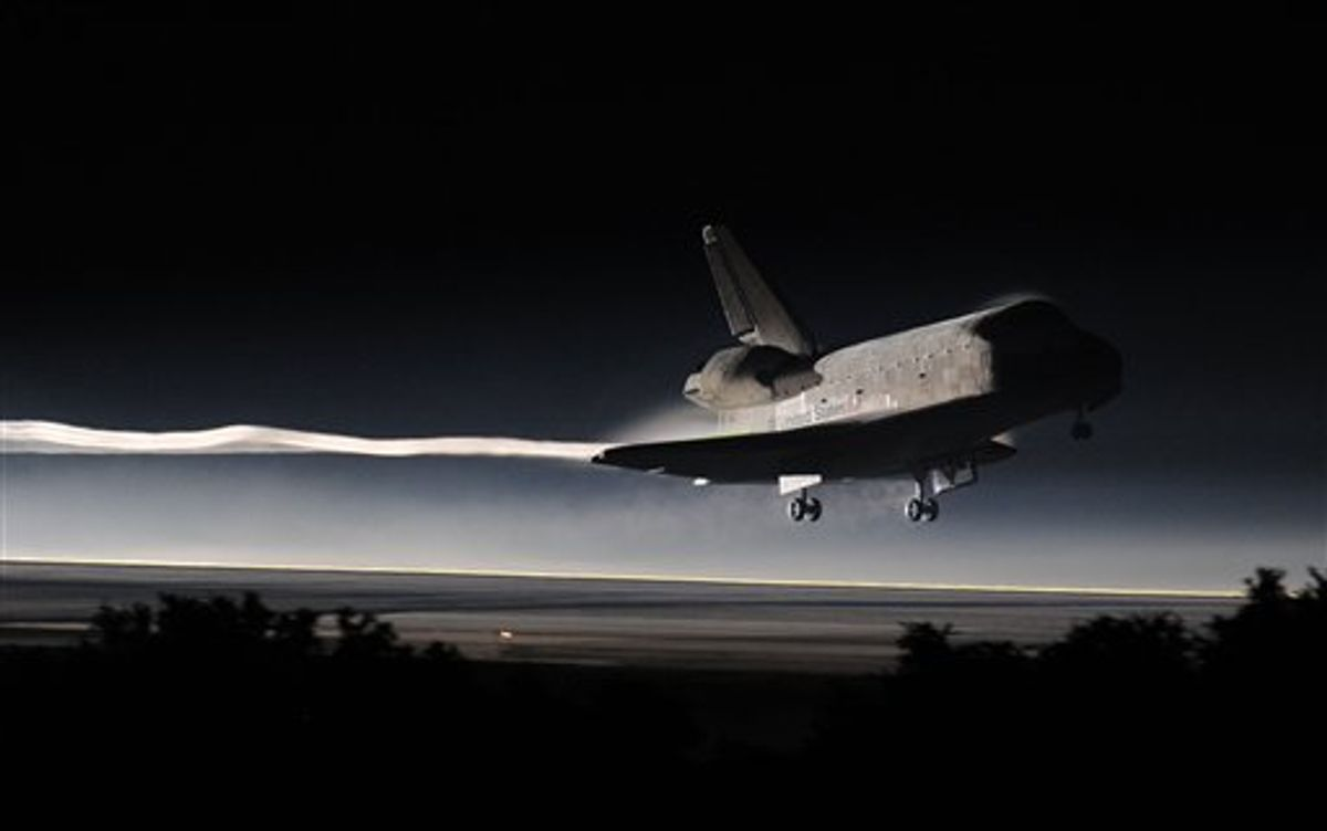 Space Shuttle Atlantis lands at the Kennedy Space Center at Cape Canaveral, Fla. Thursday, July 21, 2011. The landing of Atlantis marks the end of NASA's  30 year space shuttle program.  (AP Photo/Don Emmert, Pool)  (AP)