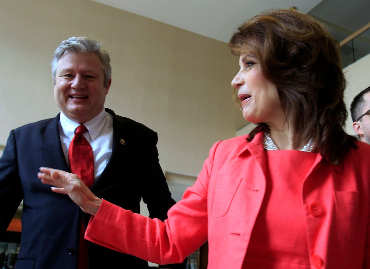 U.S. Rep. Michele Bachmann, R-Minn., arrives with her husband, Marcus, to a state GOP fundraiser Saturday, March 12, 2011 in Nashua, N.H. Bachmann recently has visited two other early nominating states and is expected to announce whether she's running for a Republican presidential nomination by early summer. (AP Photo/Jim Cole) (Jim Cole)