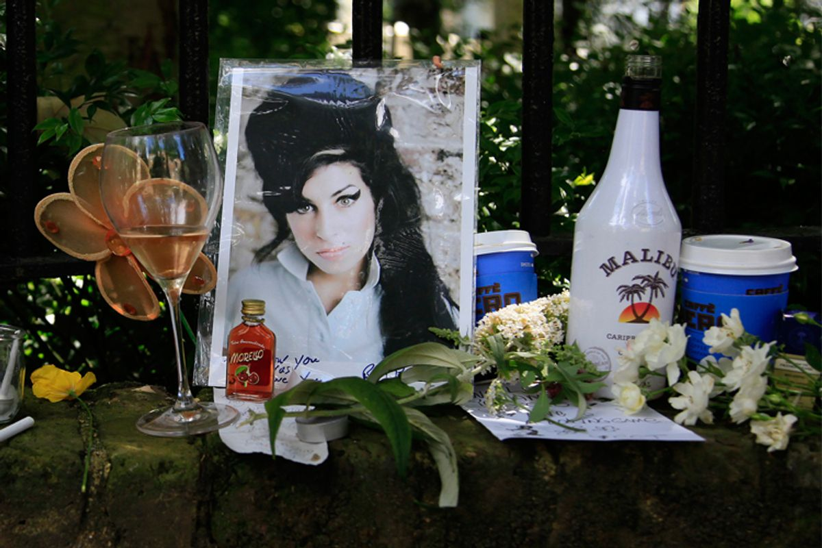 Flowers and tributes are seen outside the home of Amy Winehouse in London.