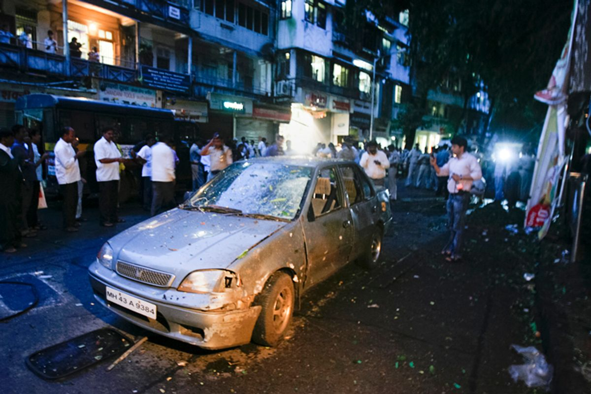 A car is seen damaged at the site of a bomb explosion in the Dadar area of Mumbai July 13, 2011. Three explosions rocked crowded districts of India's financial capital of Mumbai during rush hour on Wednesday, killing at least eight people, media said, in the biggest attack on the city since 2008 assaults blamed on Pakistan-based militants.    REUTERS/Stringer   (INDIA - Tags: CIVIL UNREST CRIME LAW)  (© Stringer India / Reuters)