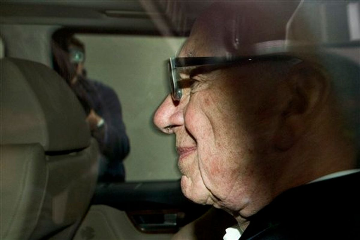 News Corporation chairman Rupert Murdoch arrives at his residence in central London, Wednesday, July 13, 2011. News Corporation announced Wednesday it has dropped its bid to takeover British Sky Broadcasting (BskyB), after the British tabloid newspaper News of the World is accused of hacking into the mobile phones of various crime victims, celebrities and politicians.(AP Photo/Sang Tan)  (AP)